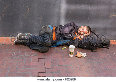 a-30s-homeless-man-sleeps-lying-down-on-a-sidewalk-in-san-francisco-f2828k[1]